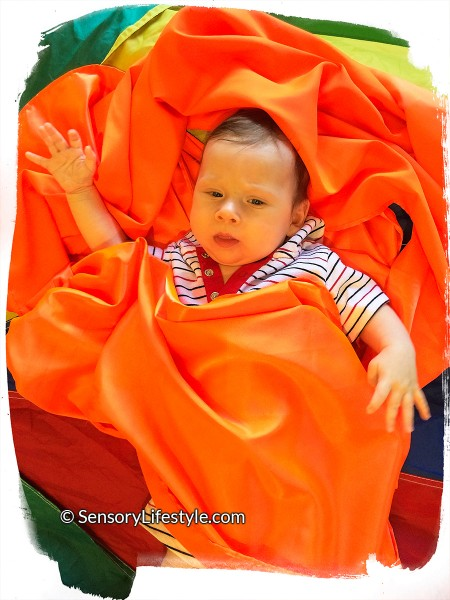 2 month baby activities: playing in fabric