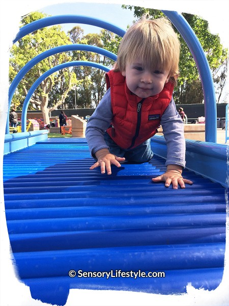 Magical Bridge Playground - Josh inside roller table