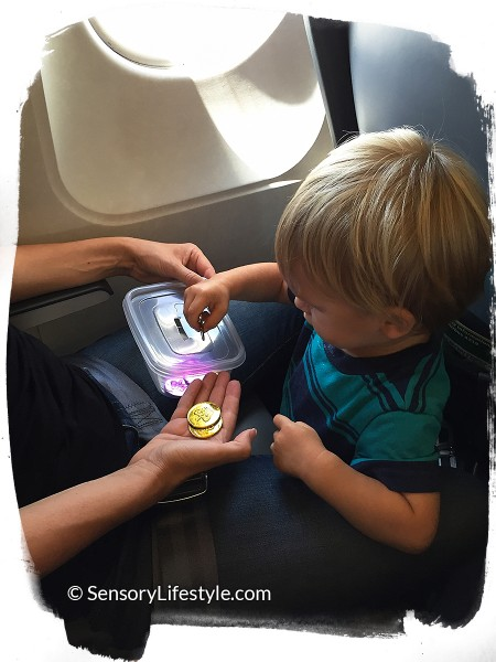 Travel activities for toddler: Playing with coins