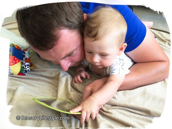 3 month baby activities: Playing with a mirror