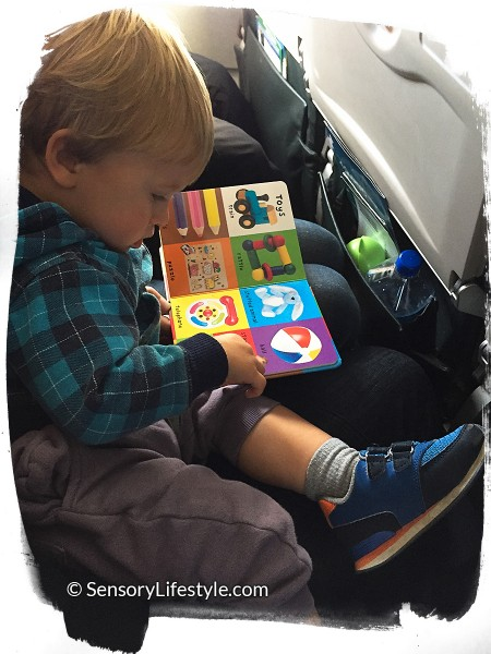 Travel activities for toddler: Reading a book