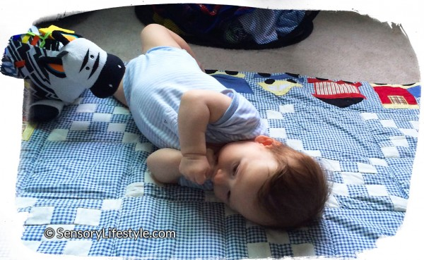 3 month baby activities: Rolling over