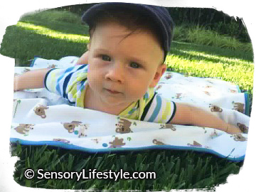 3 month baby activities: Tummy Time on the grass