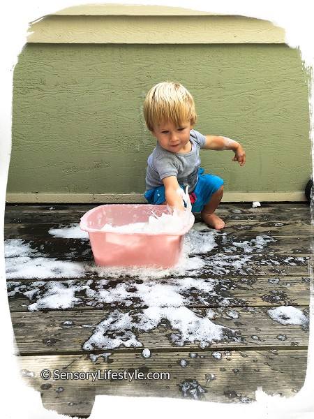 16 month toddler activities: Playing in clean mess
