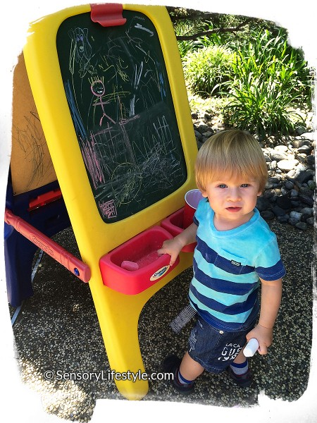 18 month old toddler activities: Josh drawing with chalk