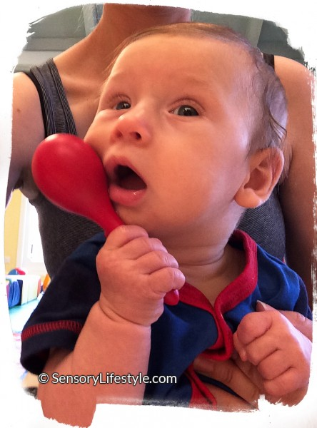 4 month old baby activates: Josh with rattle