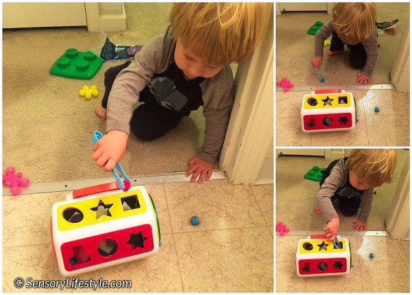 23 month toddler activities: pom pom squeeze