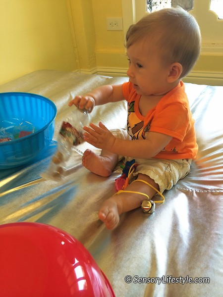 9 month old baby activities: Shaker